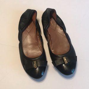 Cole Haan black flats, size 9